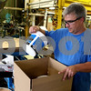 Rob Winner – rwinner@daily-chronicle.com<br /> On Tuesday afternoon, IDEAL Industries' employee Jeff Cristallo boxes up containers of a wire lubricant which is biodegradable and non-toxic.<br /> 07/14/2009