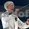 Randi Stella – rstella@daily-chronicle.com<br /> <br /> Dee Palmer conducts the DeKalb Municipal Band in Hopkins Park, in DeKalb, Ill., on Tuesday, August 18th, 2009.