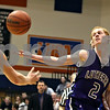 Beck Diefenbach  -  bdiefenbach@daily-chronicle.com<br /> <br /> Rockford Lutheran guard Eric Widstrom (2) stretches for a loose ball during the second quarter of the game against Geno-Kingston at GK in Genoa, Ill., on Friday Jan. 16, 2009. Lutheran beat GK 46 to 39.
