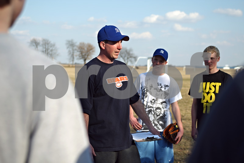 Beck Diefenbach  -  bdiefenbach@daily-chronicle.com<br /> <br /> Hinckley-Big Rock baseball head coach Matt Olson talks with his players during practice at HBR High School in Hinckley, Ill., on Monday March 16, 2009.