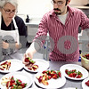 Beck Diefenbach  -  bdiefenbach@daily-chronicle.com<br /> <br /> Robin Schoenburg (left), of Sycamore, and her son Alan prepares fruit for desert during a Passover seder meal hosted by Congregation Beth Shalom in DeKalb, Ill., on Thursday April 9, 2009.