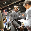 Beck Diefenbach – bdiefenbach@daily-chronicle.com<br /> <br /> Nsikak Okoh, an Northern Illinois University Alumnus, waits as Maria Hancock, senior recuiter for Federal Reserve Bank of Chicago, looks over his resume at the NIU Convocation Center in DeKalb, Ill., on Wednesday Feb. 25, 2009. Hancock has noticed an increase in graduate students and alumni at the fair.