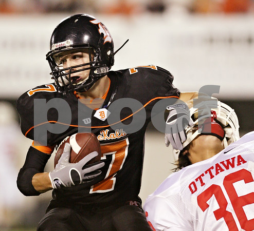 Beck Diefenbach  -  bdiefenbach@daily-chronicle.com<br /> <br /> DeKalb defensive back Dylan Donnelly (7) intercepts a ball over Ottawa's Mark Hernandez (36) during the first quarter of the game at Huskie Stadium of Northern Illinois University in DeKalb, Ill., on Friday Aug. 28, 2009.