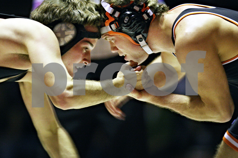 Beck Diefenbach  -  bdiefenbach@daily-chronicle.com<br /> <br /> DeKalb's Tyler Walt clasps hands with Sycamore's Kevin Woodstrup during the 130 weight class match at DeKalb High School in DeKalb, Ill., on Thursday Jan. 22, 2009.