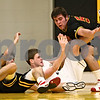 Beck Diefenbach  -  bdiefenbach@daily-chronicle.com<br /> <br /> Batavia forward Ricky Clopton (22) and forward Alex Berg (52) struggle with Sycamore's Joseph Strack (2) for a loose ball during the second quarter of the game at Sycamore High School on in Sycamore, Ill., on Tuesday Jan. 6, 2009.