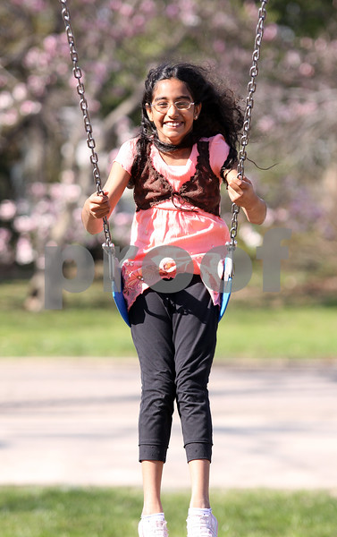 WENDY KEMP/FOR THE DAILY CHRONICLE<br /> Third grade student Mahitha Takkasila enjoys swinging during the after school program at West Elementary in Sycamore on Friday.<br /> 4/24/09 Sycamore
