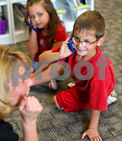 Beck Diefenbach  -  bdiefenbach@daily-chronicle.com<br /> <br /> North Elementary School kindergartner Zack Sandy pretends to talk on a phone after typing numbers into his calculator during Lisa Winters' class in Sycamore, Ill., on Friday Sept. 25, 2009.