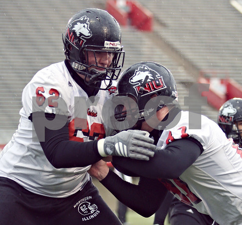 Beck Diefenbach  -  bdiefenbach@daily-chronicle.com<br /> <br /> Northern Illinois' Trevor Olson (62) and Jason Schepler (87) during practice at NIU's Huskie Stadium in DeKalb, Ill., on Tuesday March 24, 2009.