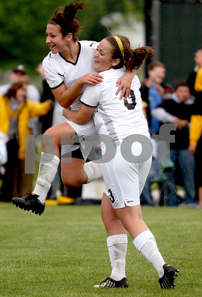 Rob Winner – rwinner@daily-chronicle.com<br /> Nici Newquist (left) and Brian Henke celebrate Henke's direct free kick goal in the first half of the Class 2A Rochelle Supersectional on Tuesday.<br /> 06/02/2009