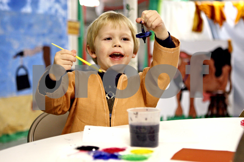"Rob Winner – rwinner@daily-chronicle.com<br /> Hayden Thompson, 4, of Sycamore, paints a top during ""A Night In Bethlehem"" at Cortland United Methodist Church on Saturday December 12, 2009 in Cortland, Ill."