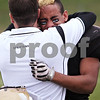 Beck Diefenbach  -  bdiefenbach@daily-chronicle.com<br /> <br /> Sycamore's Marckie Hayes (1, right) is embraced by head coach Joe Ryan following their team's loss to Montini in the playoff game at Sycamore High School in Sycamore, Ill., on Saturday Nov. 14, 2009.