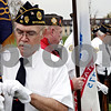 Rob Winner – rwinner@daily-chronicle.com<br /> Honor guard member Wes Lundsberg puts on a pair of white gloves before a service at the St. Mary Cemetery in DeKalb on Thursday October 29, 2009.