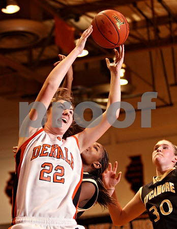 Beck Diefenbach  -  bdiefenbach@daily-chronicle.com<br /> <br /> DeKalb's Emily Bemis (22) grabs a rebound during the second quarter of the game against Sycamore at DeKalb High School in DeKalb, Ill., on Tuesday Dec. 1, 2009. Sycamore defeated DeKalb 38 to 33.