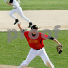 Rob Winner – rwinner@daily-chronicle.com<br /> In the bottom of the first inning, Sycamore's Trevor Mathey (top) heads to second base, while Batavia pitcher Adam Karger throws to home after fielding a grounder for the force. <br /> 04/24/2009<br /> it turned out to be a 123 double play