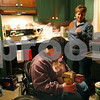 Beck Diefenbach – bdiefenbach@daily-chronicle.com<br /> <br /> Emily Lampkin, 20, of Sycamore, opens a box of garlic bread under the watch of her mother Jacque as they prepare dinner together at their home in Sycamore, Ill., on Thursday Feb. 19, 2009. Emily, who lives with Spina Bifida and Shunted Hydrocephalus, practices at home what she has learned at Life School.