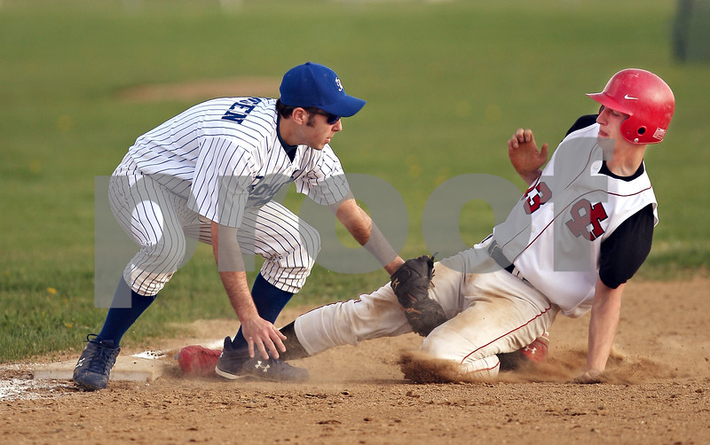 Beck Diefenbach  -  bdiefenbach@daily-chronicle.com<br /> <br /> Indian Creek's Danny Jensky (13) is out at third base by Hinckley-Big Rock's Dylan Johnsen (1) during the fifth inning of game at HBR High School in Hinckley, Ill., on Tuesday May 5, 2009.