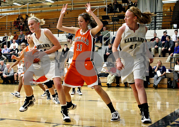 Rob Winner – rwinner@daily-chronicle.com<br /> Rob Winner – rwinner@kcchronicle.com<br /> Kaneland's Kelly Evers controls a rebound under DeKalb's basket in the first quarter.<br /> 12/04/2009