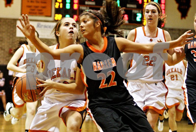 Rob Winner – rwinner@daily-chronicle.com<br /> <br /> DeKalb's Alli Smith looks to take a shot while being pressured by Harlem's Paige Graham (22) in the first quarter on Tuesday November 16, 2010 in DeKalb, Ill.