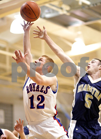 Beck Diefenbach  -  bdiefenbach@daily-chronicle.com<br /> <br /> Hinckley-Big Rock's Brian Michaels (12, left) shoots the ball ahead of Hiawatha's Jason Keneway (5) during the first half of the game against Hiawatha at H-BR High School in Hinckley, Ill., on Tuesday Jan. 12, 2009.