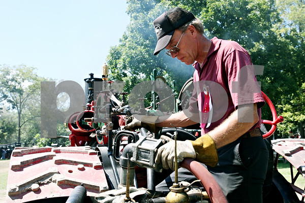Rob Winner – rwinner@daily-chronicle.com<br /> <br /> Sycamore resident Dave Stevens fills his 1916 Illinois steam engine with water before the start of the parade for the Sycamore Steam Show & Threshing Bee in Sycamore, Ill., on Thursday August 12, 2010.