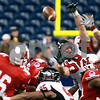 Kyle Bursaw – kbursaw@daily-chronicle.com<br /> <br /> Northern Illinois defensive tackle Mike Krause knocks down a Miami (OH) quarterback Austin Boucher pass during the second quarter of the MAC Championship game between the Northern Illinois Huskies game and the Miami (Ohio) Redhawks<br /> at Ford Field in Detroit, Mich. on Friday, Dec. 3, 2010.