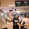 Beck Diefenbach  -  bdiefenbach@daily-chronicle.com<br /> <br /> DeKalb junior Brandi Underwood (center) gets a high-five from head coach Bill Holland (far left) during bowling practice at Mardi Gras Lanes in DeKalb, Ill., on Tuesday Feb. 9, 2010.
