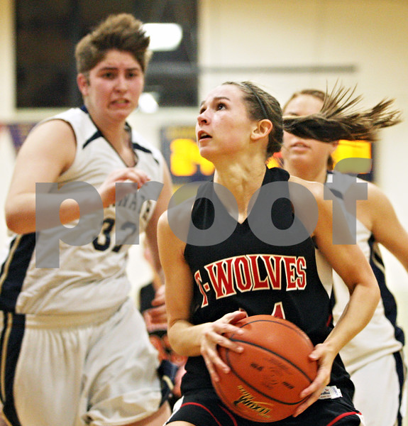 Rob Winner – rwinner@daily-chronicle.com<br /> <br /> Indian Creek's Ariel Russell goes to the basket during the third quarter in Kirkland on Thursday. Indian Creek went on to defeat Hiawatha, 43-40.
