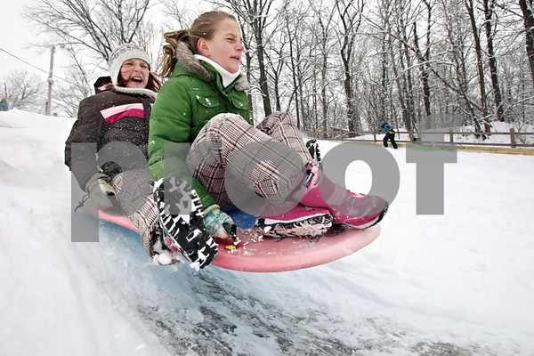 Rob Winner – rwinner@daily-chronicle.com<br /> Friends Allie Schmidt (left), 10, and Madison Mollman, 11, both of Sycamore spent there snow day sledding at Russell Woods Forest Preserve in Genoa, Ill. on Thursday January 7, 2010.