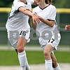 Beck Diefenbach  -  bdiefenbach@daily-chronicle.com<br /> <br /> Sycamore's Lauren Miller (17, center) is congratulated by Lindsey Hemmerich (16, left) following Miller's goal during the second half of the IHSA Class 2A Hampshire Sectional Semi-final game against Rosary at Hampshire High School in Hampshire, Ill., on Tuesday May 25, 2010. Sycamore defeated Rosary 3 to 1.