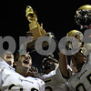 Beck Diefenbach – bdiefenbach@daily-chronicle.com<br /> <br /> Sycamore football players cheer with the trophy following the game between DeKalb and Sycamore High Schools at Huskie Stadium on the campus of Northern Illinois University in DeKalb, Ill., on Friday Sept. 10 2010.