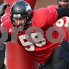 Rob Winner – rwinner@daily-chronicle.com<br /> <br /> NIU defensive tackle Mike Krause works out during practice at Huskie Stadium in DeKalb, Ill. on Thursday April 8, 2010.