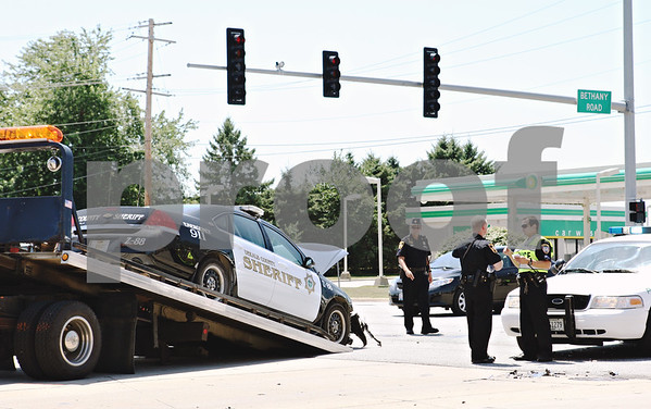 Rob Winner – rwinner@daily-chronicle.com<br /> <br /> A DeKalb County Sheriff's vehicle is lifted onto a tow truck after an accident at the intersection of Bethany and Sycamore roads on Friday July 16, 2010.