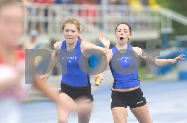 Rosary'sAly Rindone ahnds the baton off to Christine Slade in the 4x200 meter relay Friday at the Class 2A State Track Meet in Charleston.