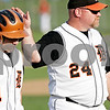 Beck Diefenbach  -  bdiefenbach@daily-chronicle.com<br /> <br /> DeKalb head coach Justin Keck consoles Jake Lemay (1) after he was unable to score at the end of the fifth inning of the game against Batavia at DeKalb High School in DeKalb, Ill., on Thursday April 15, 2010. Batavia defeated DeKalb 7 to 4.
