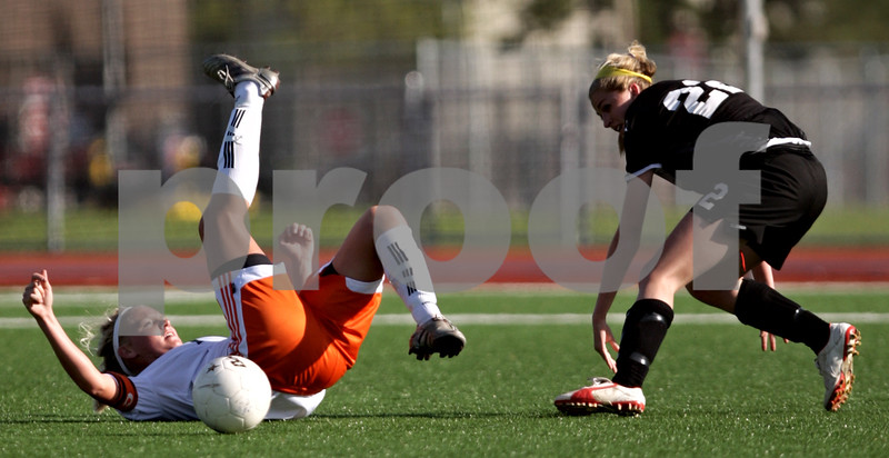 Beck Diefenbach  -  bdiefenbach@daily-chronicle.com<br /> <br /> DeKalb's Lindsey Adshade (7, left) and Sycamore's Rachel Stueber (22) tumbles during the first half of the game at Northern Illinois University in DeKalb, Ill., on Thursday April 29, 2010. Sycamore defeated DeKalb 2 to 0.