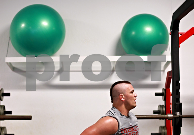 Beck Diefenbach - bdiefenbach@daily-chronicle.com<br /> <br /> Defensive lineman Ron Newcomb sports his mohawk during a workout in the weight room at the Yordon Center on the Northern Illinois University Campus in DeKalb, Ill., on Tuesday Aug. 10, 2010.
