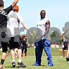 Rob Winner – rwinner@daily-chronicle.com<br /> <br /> Kansas City Chiefs wide receiver Chris Chambers watches as local youth football players stretch at the start of a football camp at DeKalb High School on Saturday June 19, 2010.