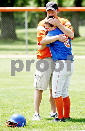 Rob Winner – rwinner@daily-chornicle.com<br /> <br /> Genoa-Kingston assistant coach Scott Miller tries to console Laura Volkening after the Cogs were defeated by Stillman Valley for the IHSA Class 2A Byron Regional championship in Byron, Ill. on Saturday May 22, 2010.