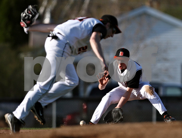 Beck Diefenbach  -  bdiefenbach@daily-chronicle.com<br /> <br /> DeKalb's Brian Sisler (22, right) fields a ground ball during the third inning of the game against Sycamore at DeKalb High School in DeKalb, Ill., on Friday April 9, 2010.