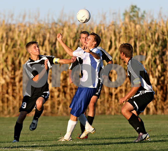 Rob Winner - rwinner@daily-chronicle.com<br /> <br /> Hinckley-Big Rock's Jacob Madden tries to control a ball while surrounded by three Kaneland defenders during the first half of their game on Wednesday September 8, 2010 in Hinckley, Ill.