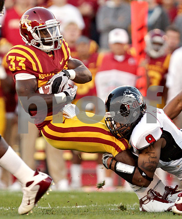 Beck Diefenbach  -  bdiefenbach@daily-chronicle.com<br /> <br /> Iowa State running back Alexander Robinson (33, left) is taken down by Northern Illinois linebacker Devon Butler (9) during the first quarter of the game at Jack Trice Stadium on the campus of Iowa State University in Ames, Iowa, on Thursday Sept. 2, 2010. Iowa State defeated Northern Illinois 27 to 10. Iowa State defeated Northern Illinois 27 to 10.