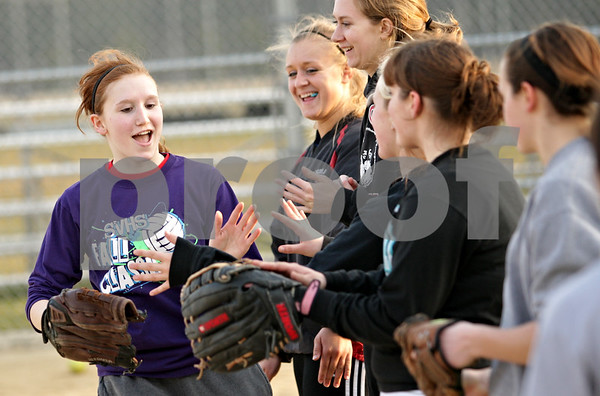 Beck Diefenbach  -  bdiefenbach@daily-chronicle.com<br /> <br /> Indian Creek's Jennifer Westbrook (left) celebrates with her team during practice at Indian Creek High School in Shabbona, Ill., on Friday March 19, 2010.