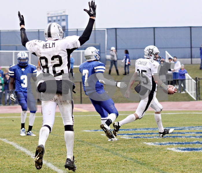 Wendy Kemp - For The Chronicle<br /> <br /> Kaneland's Daniel Helm (82) cheers as teammate Sean Carter (25) scores a touchdown during Saturday's playoff game against Vernon Hills High School.