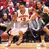 Kyle Bursaw – kbursaw@daily-chronicle.com<br /> <br /> Xavier Silas (13) drives past Shawn Deadwiler (3) in the first half. The NIU Huskies hosted the Utah Valley Wolverines on Friday, Dec. 31, 2010.