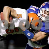 Rob Winner – rwinner@daily-chronicle.com<br /> <br /> Winnebago's Jimmy Turcato is stuffed for a loss by Genoa Kingston linebacker Robert Thurlby during the second half of their game in Genoa, Ill. on Friday October 8, 2010.