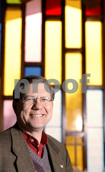 Kyle Bursaw – kbursaw@daily-chronicle.com<br /> <br /> Craig Nelson is the new pastor at Calvary Church of Lee. Here he is pictured in the library of that church on Nov. 17, 2010.