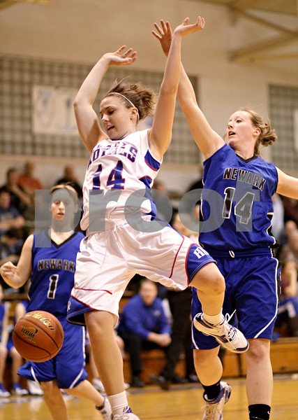 Beck Diefenbach  -  bdiefenbach@daily-chronicle.com<br /> <br /> Hinckley-Big Rock's Kaitlin Phillips (14) loses the ball after Newark's Tara Bernard (14) knocks it out of her hands during the first quarter of the game at H-BR High School in Hinckley, Ill., on Thursday Jan. 14, 2010. H-BR defeated Newark 46 to 30.
