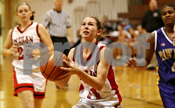 Rob Winner – rwinner@daily-chronicle.com<br /> <br /> Indian Creek's Ariel Russell puts up two with a shot during the second quarter in Shabbona, Ill. on Thursday December 2, 2010. Indian Creek went on to defeat Paw Paw, 39-15.