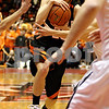 Rob Winner – rwinner@daily-chronicle.com<br /> DeKalb's Pat Rourke tries to maneuveur through Sycamore defenders while heading to the basket  during the first quarter of the Castle Challenge on Friday January 29, 2010 in DeKalb, Ill.