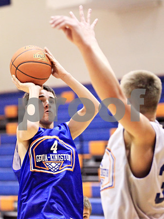 Beck Diefenbach  -  bdiefenbach@daily-chronicle.com<br /> <br /> Genoa-Kingston's Brett Lucca (4) shoots the ball during practice at G-K High School in Genoa, Ill., on Monday Jan. 4, 2010.